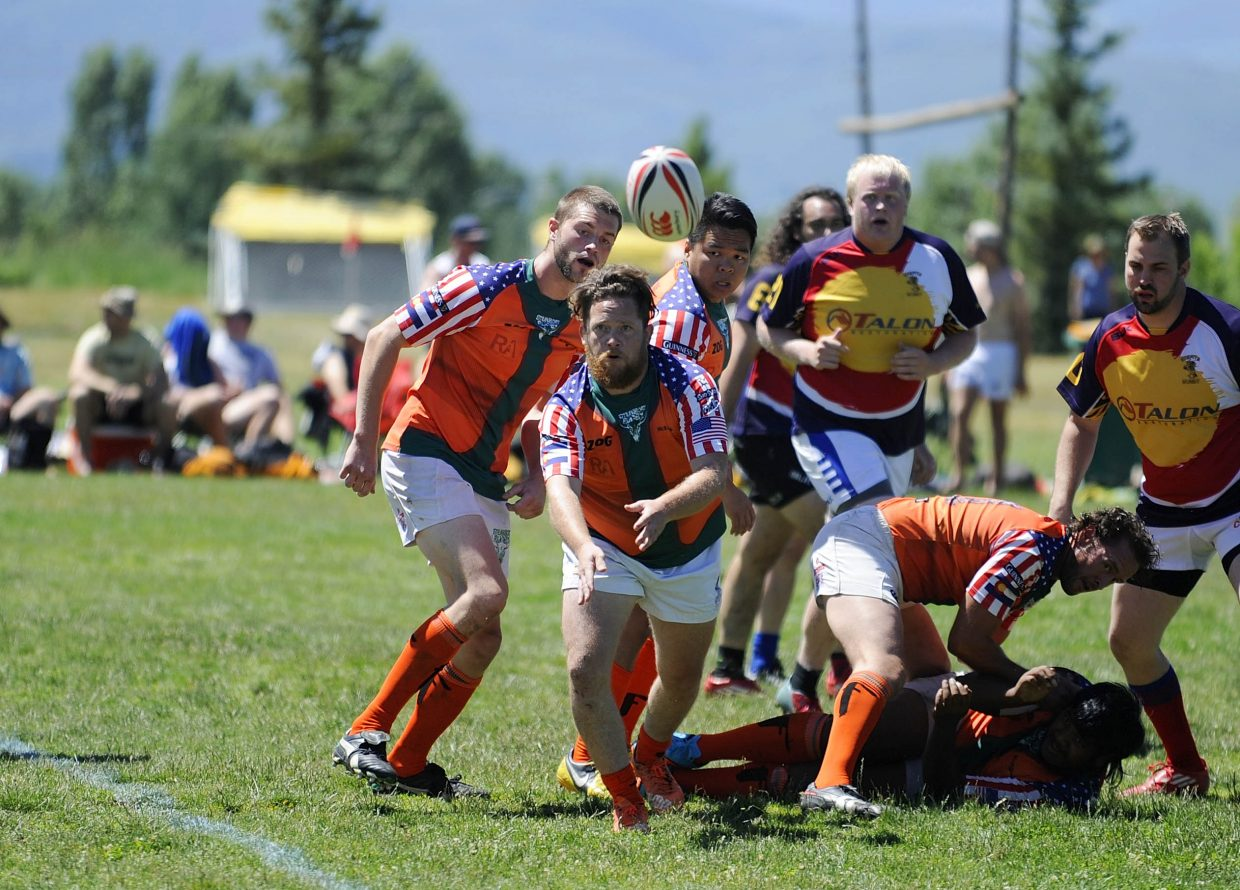 Steamboat Springs Rugby Football Club player Michael Hickey tosses the ball during Saturday's Cowpie Classic game against the Misfits.
