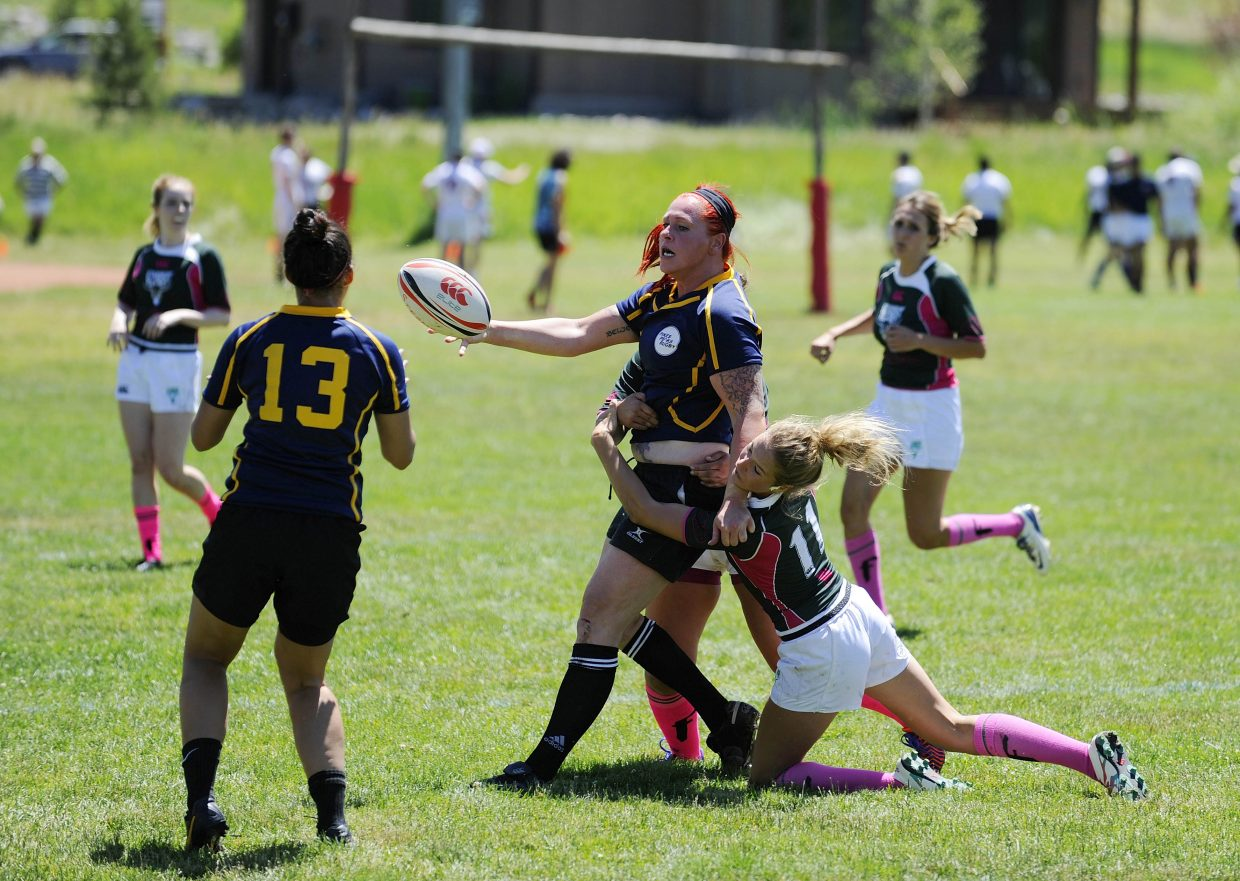 Steamboat Springs Rugby Football Club player Sam Horsley takes down a Colorado Springs player during Saturday's Cowpie Classic.