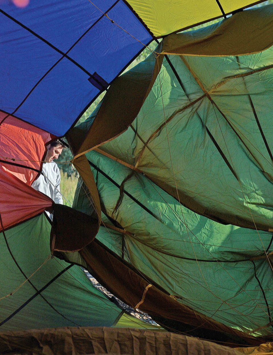 Ground crew member Brian Roe prepares a balloon for take-off Thursday morning east of Steamboat Springs.