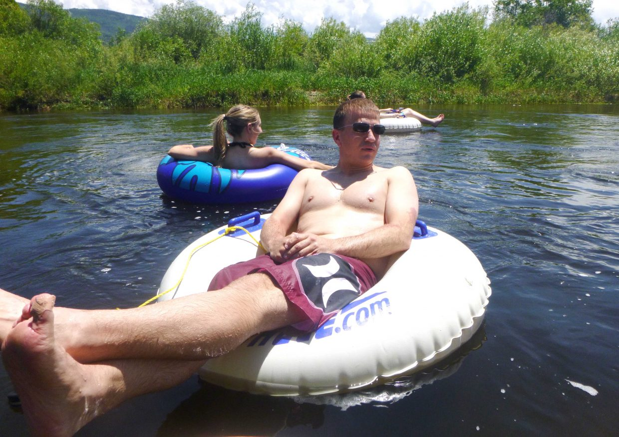 Eric Reichenberger looks ahead while floating down a calm stretch of the Yampa River on July 4. A tubing trip can be relaxing, but there's plenty to consider before a trip.