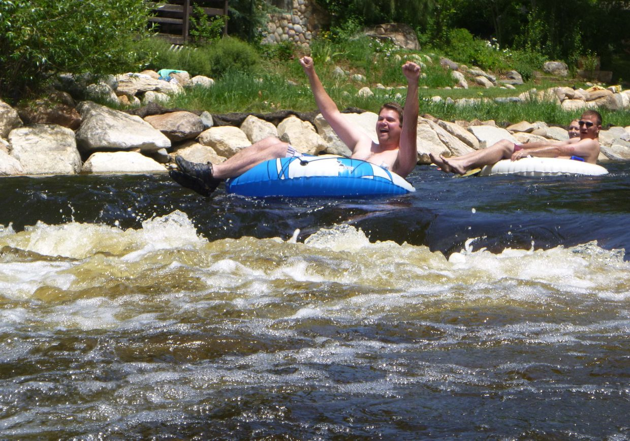 Scott Franz prepares to go over a rock in the Yampa River on July 4.
