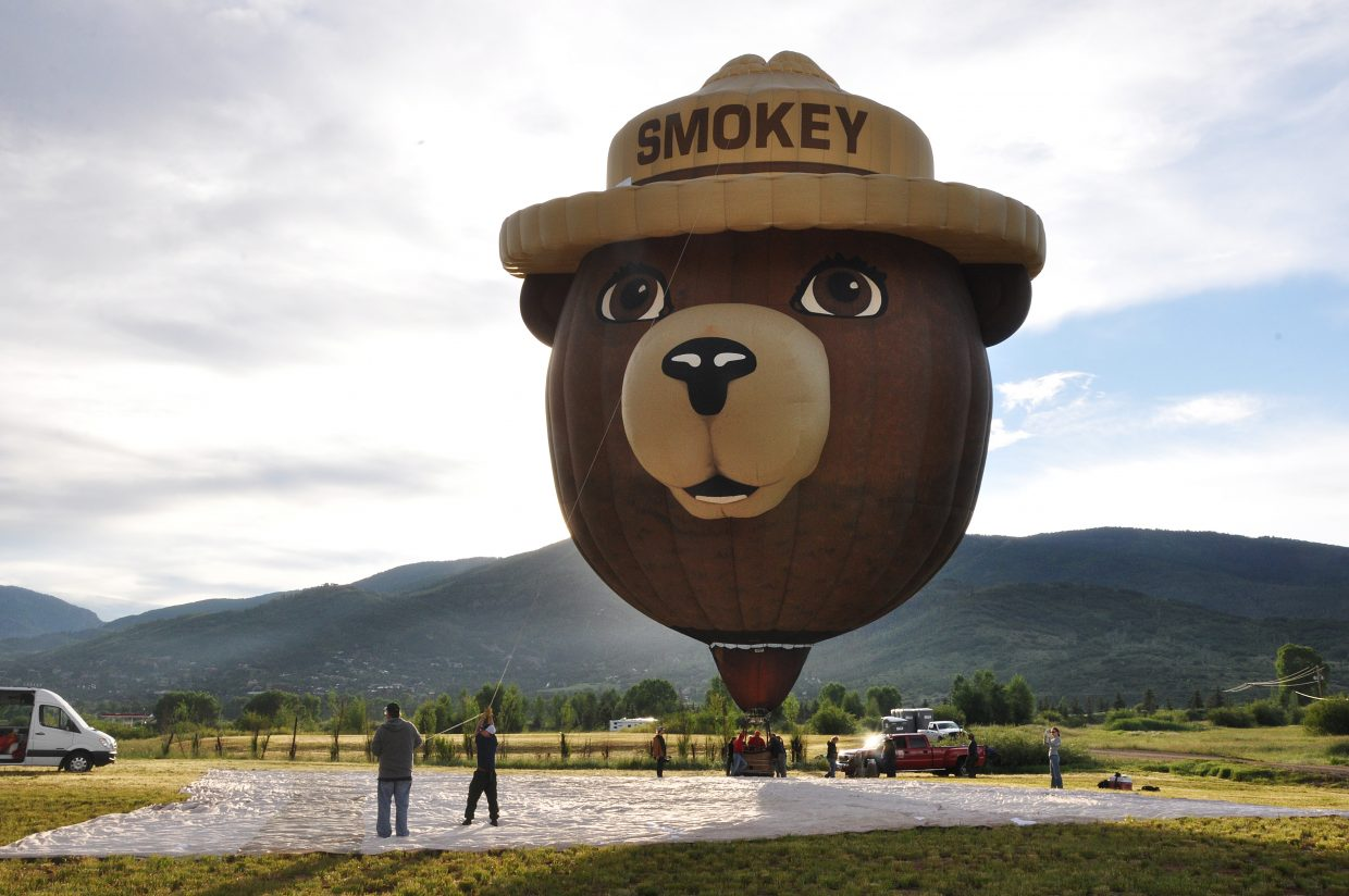 Crews inflate the Smokey Bear balloon Friday morning at Bald Eagle Lake. The balloon will be one of many on display this weekend at the Hot Air Balloon Rodeo.