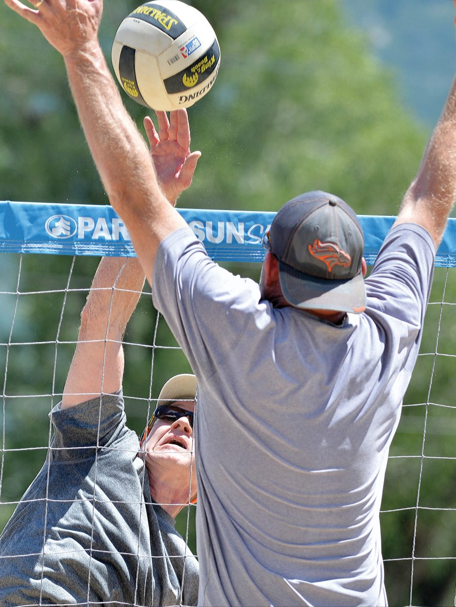 John Basey fires a shot over the net during the first day of the Steamboat Doubles volleyball tournament at Howelsen Hill. Things got started with the dinosaur division (both players ages combined must be over 80), and will ramp up today with more than 500 teams competition in 18 divisions. Matches will be played at Howelsen Hill, the sand court at Walton Village, Whistler Park, the Steamboat Springs High School and Heritage Park. Games will take place all day Saturday with the finals slated for Sunday afternoon.