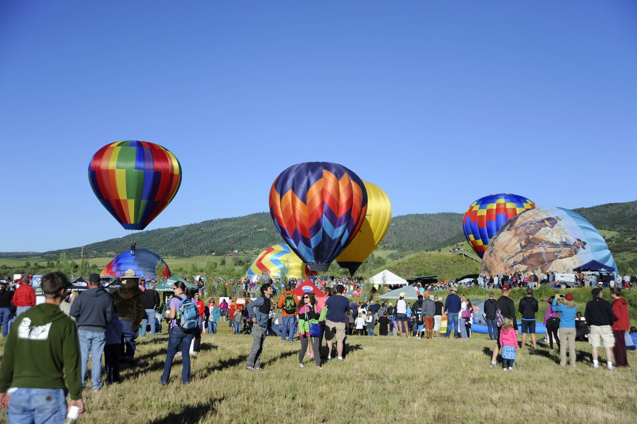 People watch balloons lift off during the 34th annual Hot Air Balloon Rodeo on Saturday at Bald Eagle Lake.