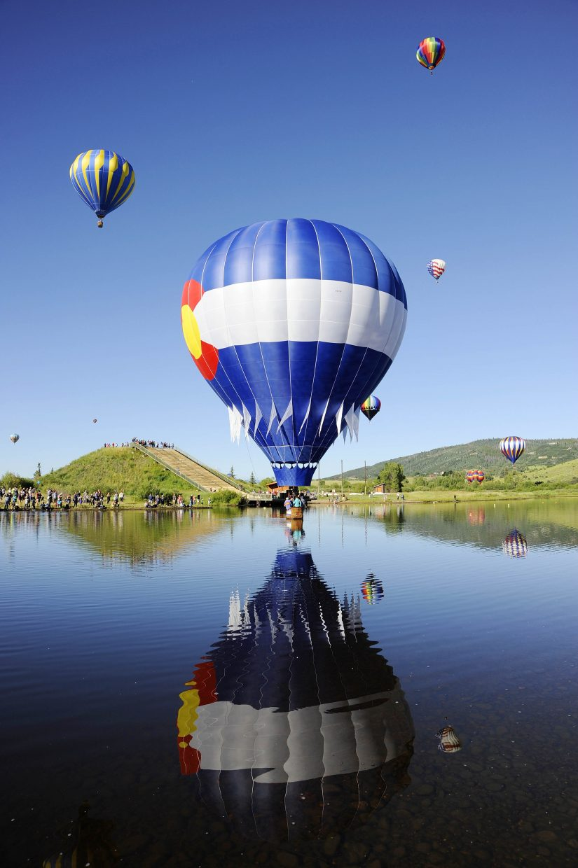 The Colorado High balloon skims the water during the 34th annual Hot Air Balloon Rodeo on Saturday at Bald Eagle Lake.