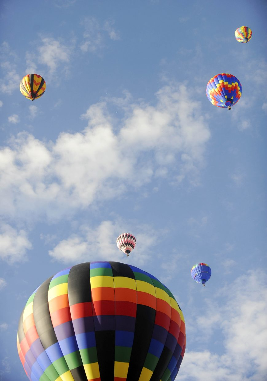 Balloons fill the sky over Steamboat Springs during Saturday's Hot Air Balloon Rodeo.