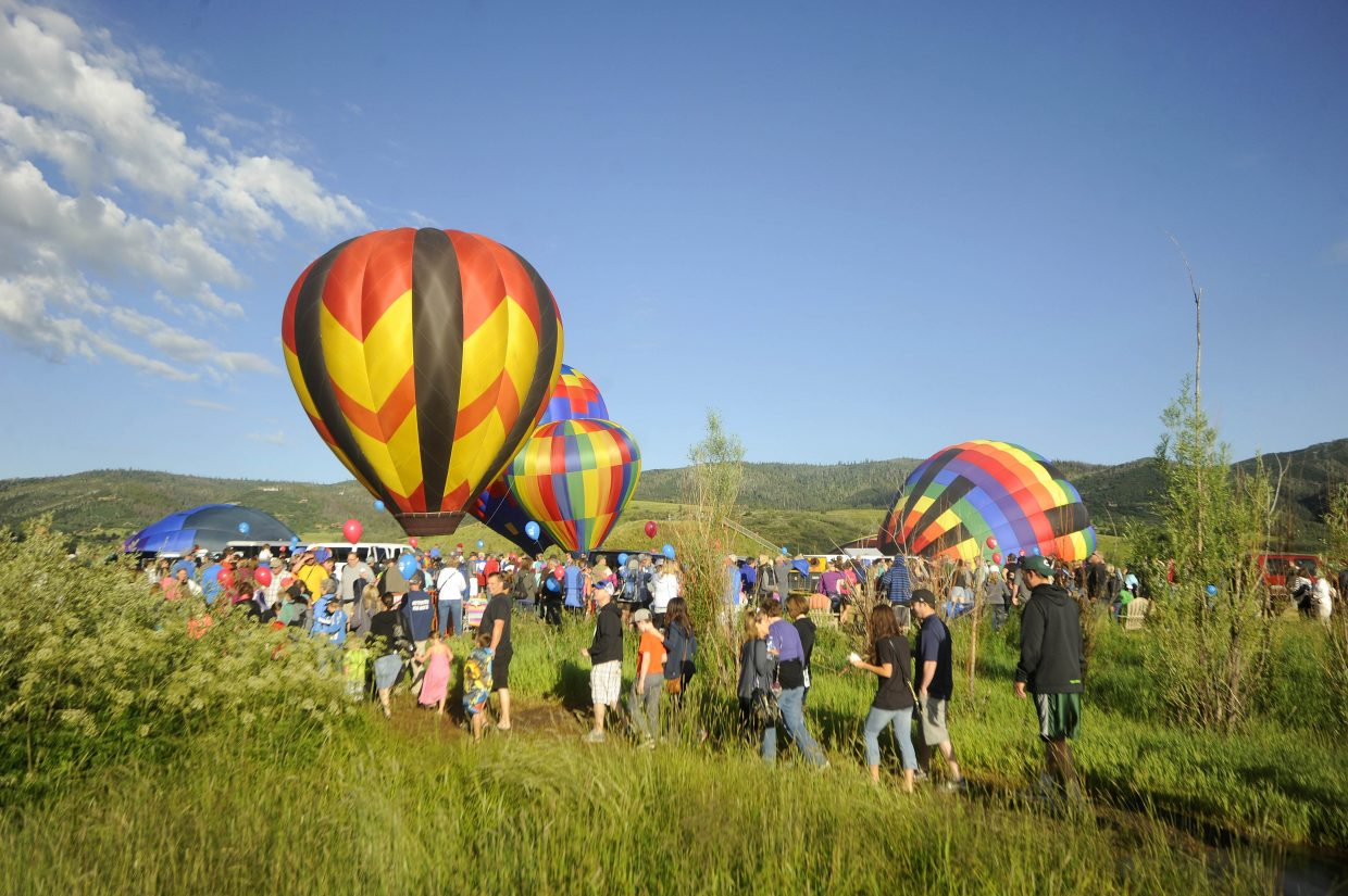 Spectators walk to the launch field at Bald Eagle Lake during Saturday's Hot Air Balloon Rodeo.