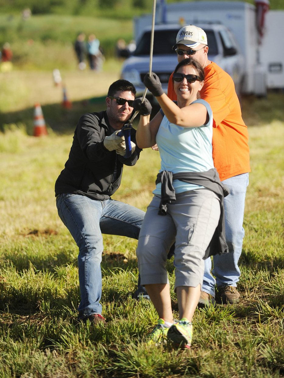 Mindy Marler and Jonathan Fetherlof hold on to a rope while helping launch a balloon during Saturday's Hot Air Balloon Rodeo.