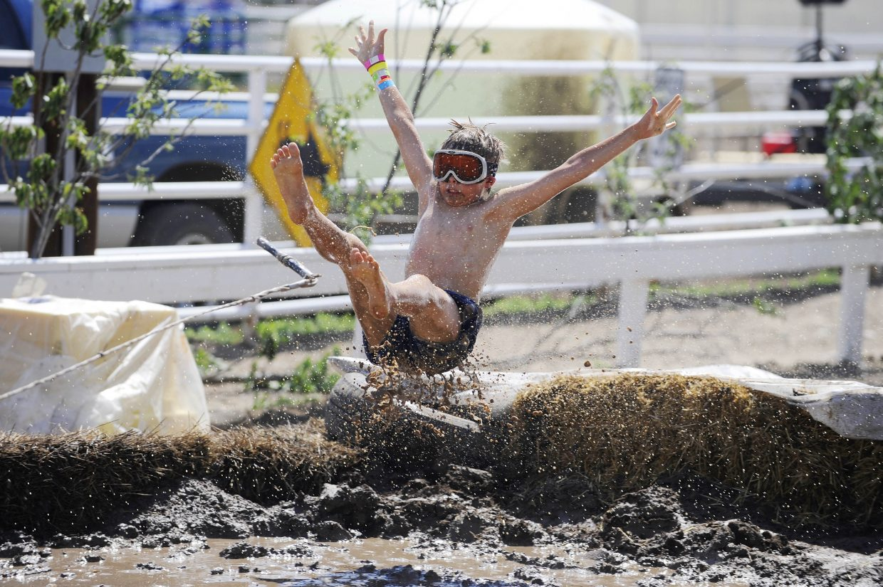 Noah Lind, 9, flies off the jump during the Kids Mud Surfing competition Saturday at the Routt County RedneX Games in Hayden.