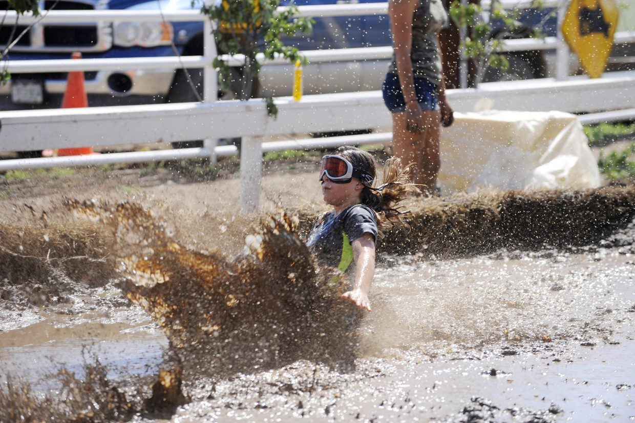 Faith Rosas, 11, crashes into the mud during the Kids Mud Surfing competition Saturday at the Routt County RedneX Games in Hayden.