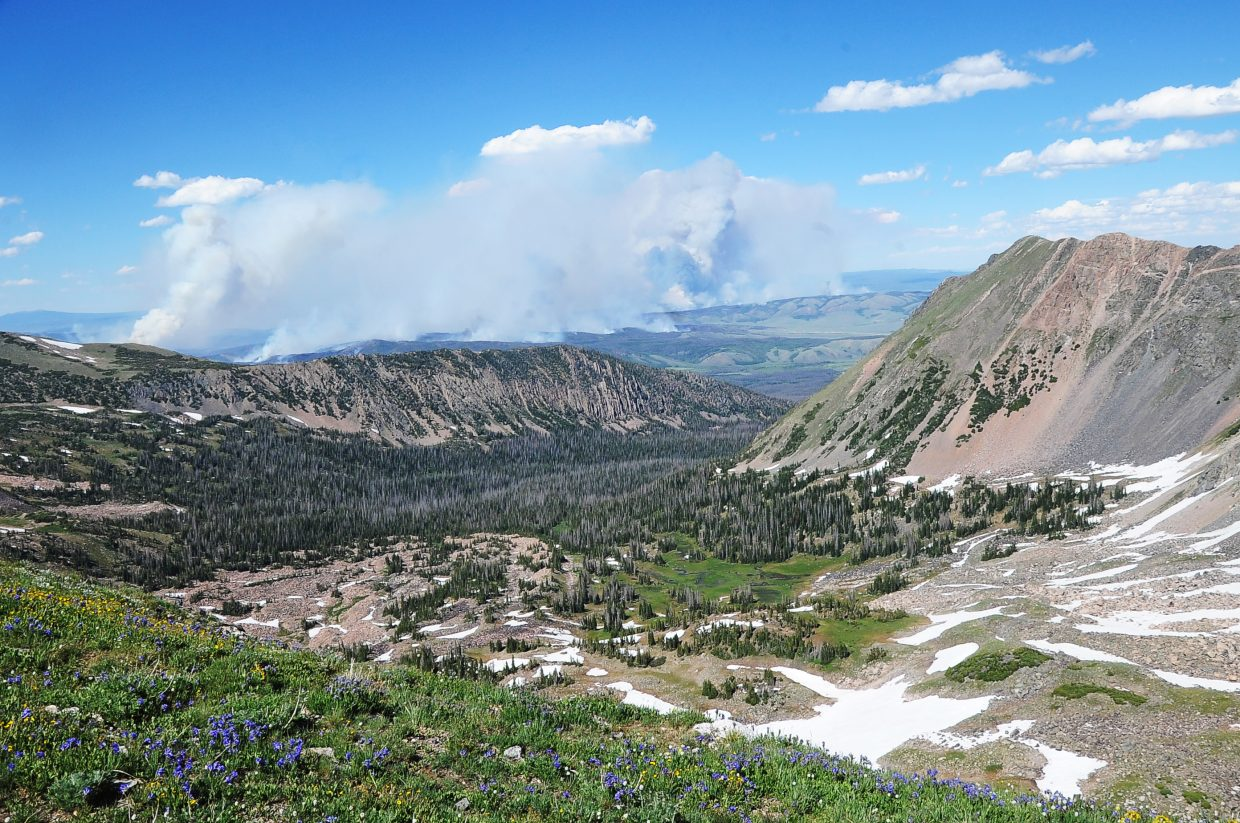The raging Beaver Creek Fire dominates the landscape in a picture taken Sunday looking east from the tundra near the summit of Mount Zirkel. The wildfire grew to 19,464 acres by Tuesday morning. There were 232 firefighters battling the blaze on Tuesday, and containment was at 5 percent. A crew of firefighters from Steamboat also left on Monday for a two-week deployment at the fire, which is located 24 miles north of Walden near the Colorado-Wyoming border.