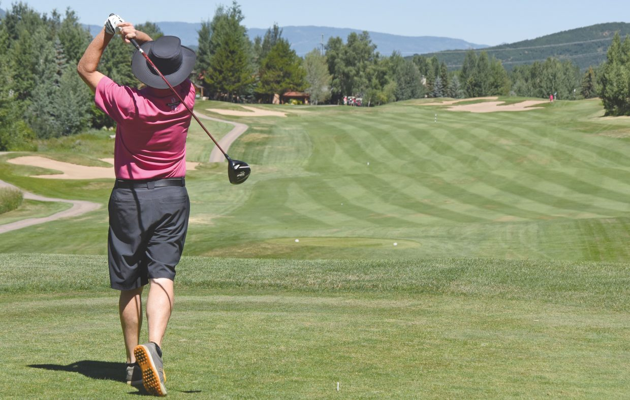 Golfer Rich Werber tees off at the Rollingstone Ranch Golf Club during Tuesday's Rally in the Valley Golf Tournament. The event, now in its 17th year, is a fundraiser for the Yampa Valley Breast Cancer Awareness Project.