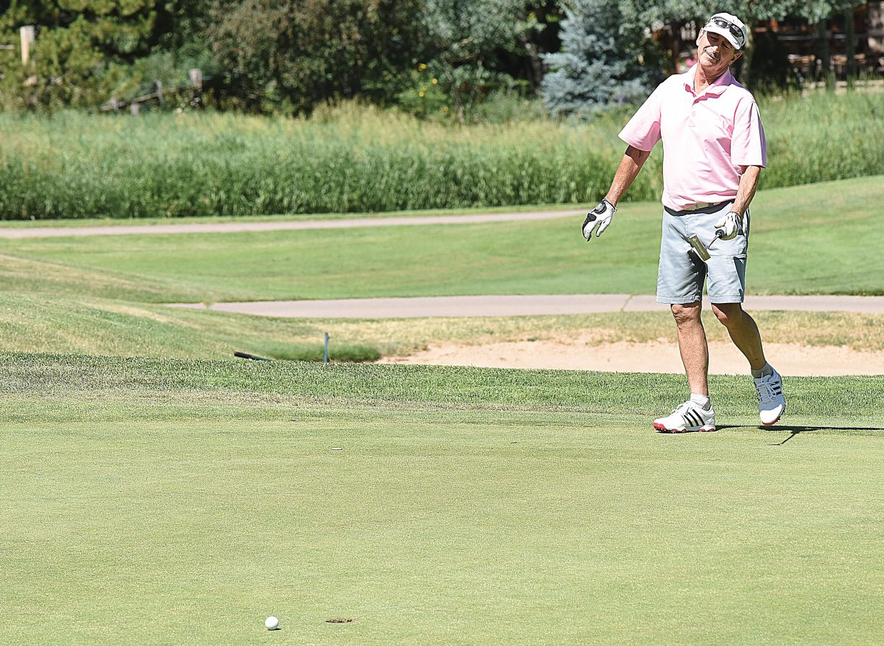 Local golfer Rich Danter looks for a little help sinking this putt during the annual Rally in the Valley golf tournament Tuesday at the Rollingstone Ranch Golf Club. The tournament benefits the Yampa Valley Breast Cancer Awareness Project and is in it's 17th year.