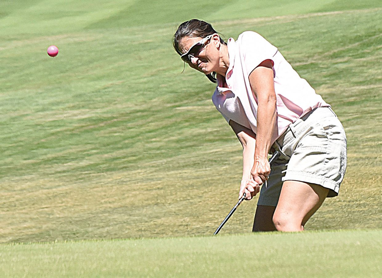 Golfer Susan Manst chips onto the green at the Rollingstone Ranch golf course Tuesday afternoon. Manst, is the daughter of Steamboat Springs resident Al Bass, and traveled to Steamboat with her family to play in the Rally in the Valley Golf Tournament.
