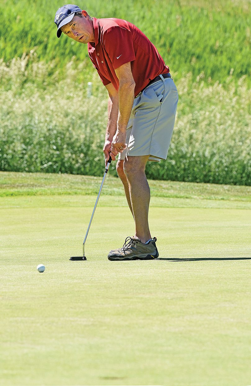 Golfer Scott Havener putts at the Rollingstone Ranch Golf Club during Tuesday's Rally in the Valley Golf Tournament. The event, now in it's 17th year, is a fundraiser for the Yampa Valley Breast Cancer Awareness Project. Havener's team finished the round with a score of 69 to win the mixed division.