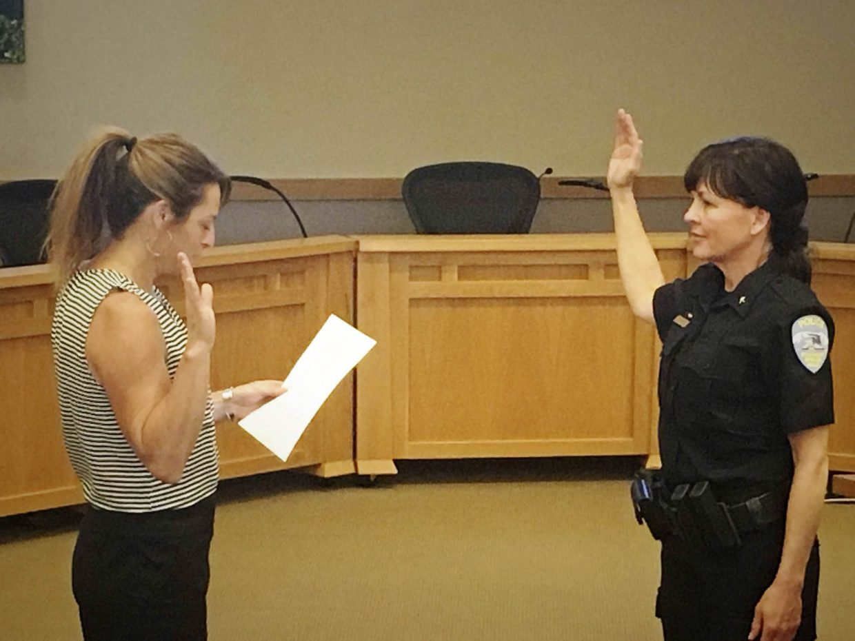 Steamboat Springs City Clerk Julie Franklin swears in newly-hired Steamboat Springs Police Department Commander Annette Dopplick on Monday at Centennial Hall. Dopplick will oversee records, evidence, investigations and animal control.