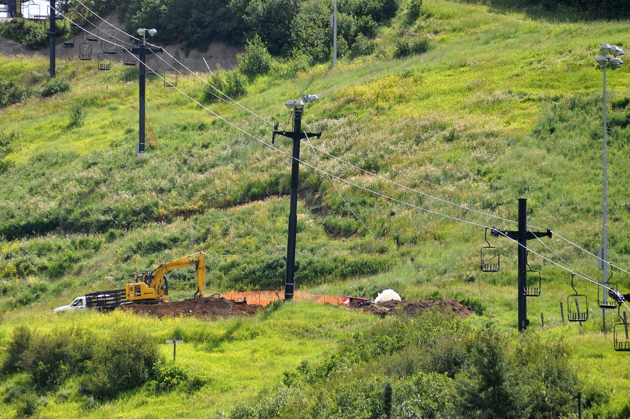 Crews have started to stabilize the soil around the lift towers on Howelsen Hill in the wake of a spring landslide.