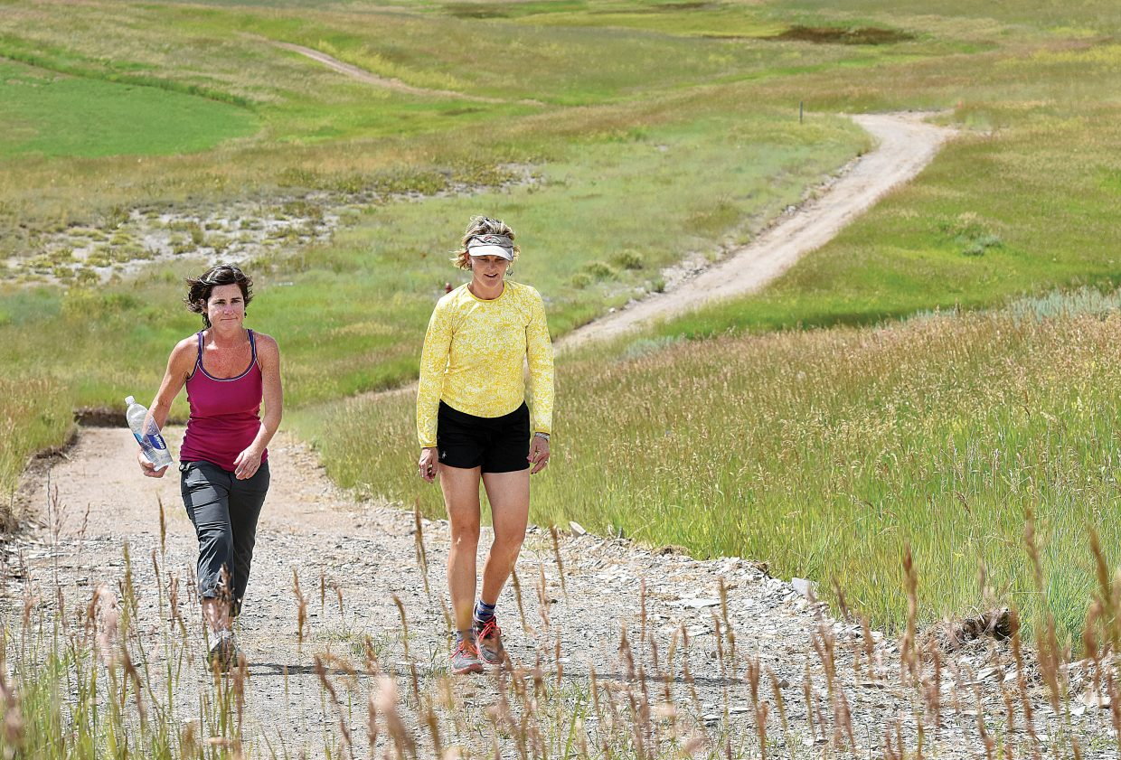 Tina Bird, left, and Megan Moore-Kemp make their way along the new West Connector Trail, which links the western city limits to the subdivisions of Silver Spur, Heritage Park and Steamboat II. The 1.5 mile trail was made possible thanks to a temporary easement from private property owners and is completely on private land. The county said it is vital for users to stay on the trail and keep their dogs on leashes in the area in order to keep the trail open in the future. The new trail provides an alternative for hikers and bikers who may want to walk to town, but don't want to brave the shoulder of U.S. Highway 40.