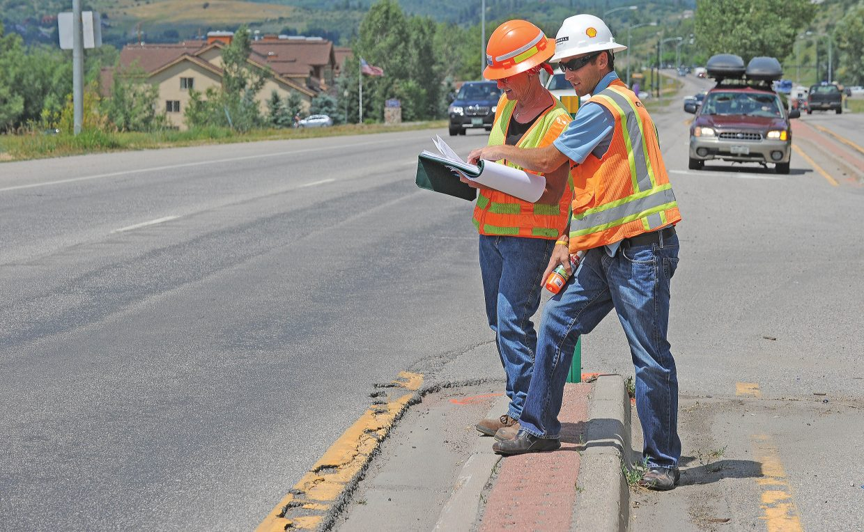 Eric Marsh, operations manager for Connell Resources, and Colorado Department of Transportation project manager Debbie McLain work on a preliminary survey for highway improvements on U.S. Highway 40 that were done in 2014.