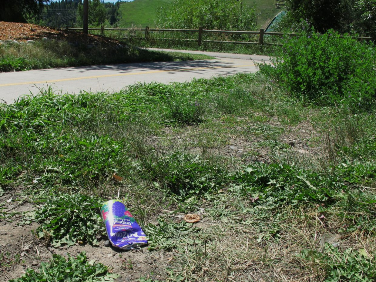 A discarded grape drink can is abandoned near the Yampa River Core Trail. The Routt County Litter Solutions Committee is asking the city to address what they say is a litter issue on the busy downtown roadway.