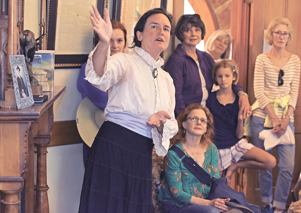 Marianne Capra plays the role of Steamboat Springs' pioneer Maggie Crawford during an open house Tuesday evening at the Historic Crawford Home in dowtown. The house, located at 1184 Crawford Avenue and was built in 1894, was the home of Steamboat Springs' founding family. On Tuesday evening, the Tread of Pioneers Museum, and the owner of the home, Jim Crawford (the great grandson on James and Maggie Crawford), invited the public inside for tours and had volunteers render a living history of the home to visitors.