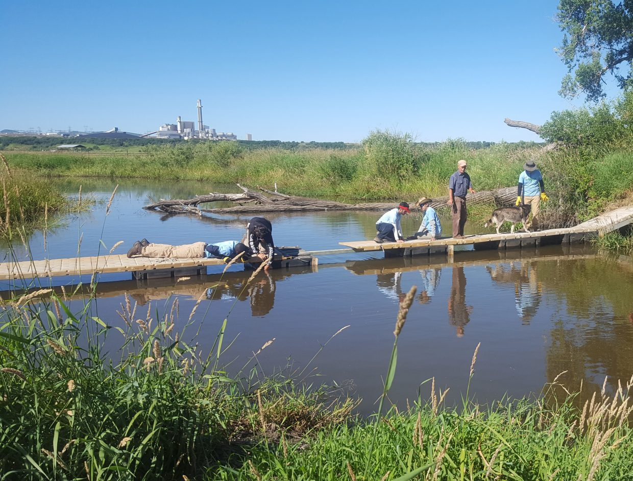 High school students from Denver and Louisville, Kentucky, remove an unwanted bridge from a slough on the Yampa River at the Carpenter Ranch July 14 while working for the Leaders in Environmental Action for the Future program, sponsored by Lowe's and The Nature Conservancy.