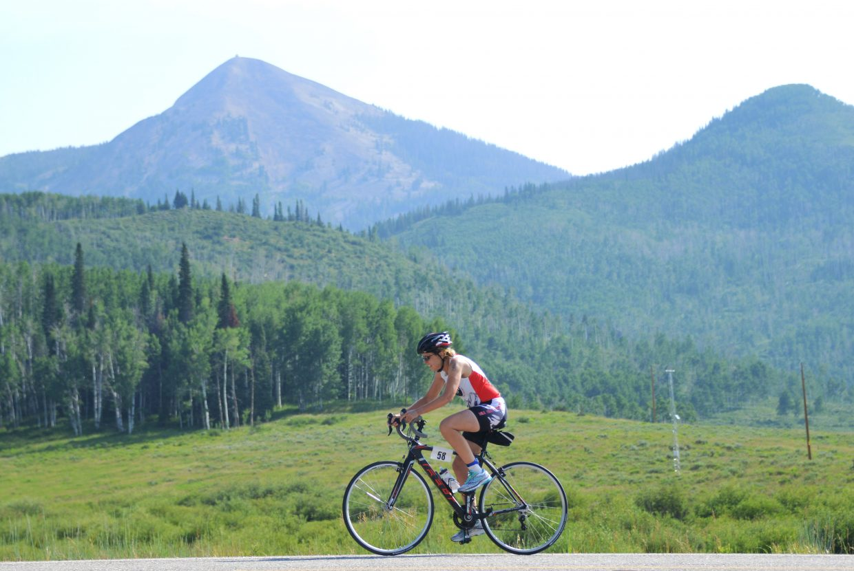 A rider passes beneath Hahn's Peak in 2014 during the Steamboat Lake Sprint Triathlon. The race returns to North Routt County on Sunday.