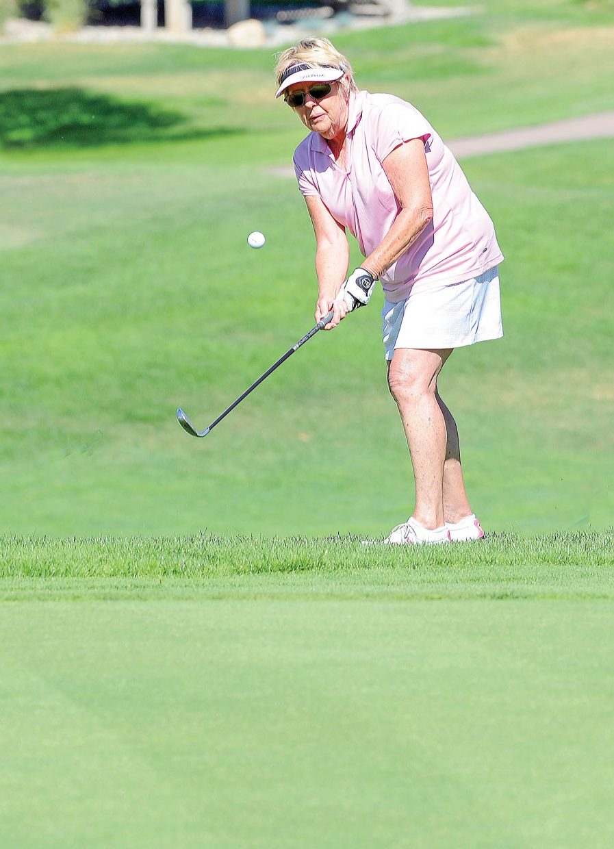 Marie Arnold chips onto the green at the Rollingstone Ranch Golf Club during the 15th annual Rally in the Valley golf tournament. The long-running event, which appears to be coming to an end, raises money for the Yampa Valley Breast Cancer Awareness Project.