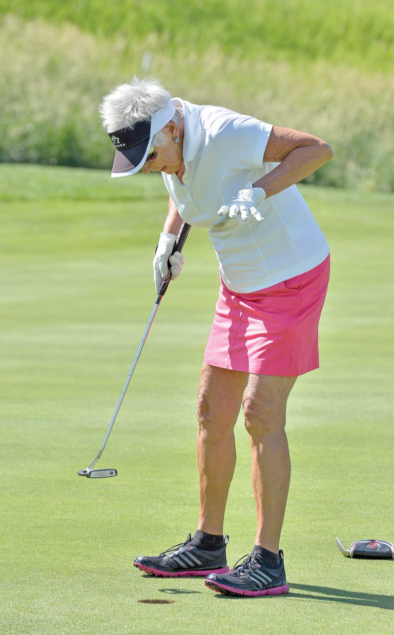 Margo McCombs reacts after sinking a short putt at the Rally in the Valley golf tournament Tuesday morning at the Rollingstone Ranch Golf Club. The long-running event, which appears to be coming to an end, raises money for the Yampa Valley Breast Cancer Awareness Project.