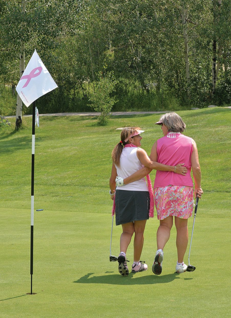 Linda Danter, right, and Robin Crossan walk away from the Rally in the Valley golf tournament. After 15 years in Steamboat Springs, the long-running event, which appears to be at an end, raised more than $300,000 for local cause and national causes, including the Yampa Valley Breast Cancer Awareness Project.