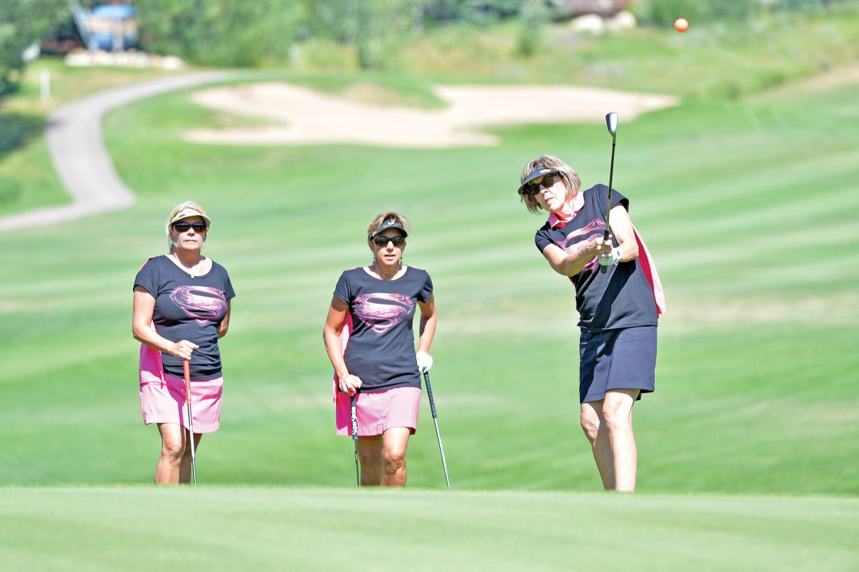 Ginna Riggall chips onto the green at the Rally in the Valley golf tournament Tuesday morning at the Rollingstone Ranch Golf Club. The long-running event, which appears to be coming to an end, raises money for the Yampa Valley Breast Cancer Awareness Project. Riggall was playing with Cathleen Albert, left, and Jane Videtich, right, and Barb Dearing, not pictured. The group, which traveled to Steamboat form south of Denver, won the women's division.