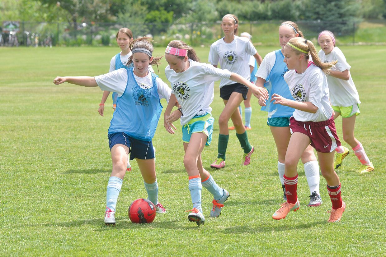 Caitlin Smith, right, and Waverly Gebhardt battle for the ball during the Steamboat Springs Soccer Academy at Emerald Park on Tuesday afternoon. The four-day camp draws locals and visiting players from across the state to Steamboat Springs prior to the start of the Steamboat Mountain Soccer Tournament. That event begins Friday morning in Steamboat Springs.