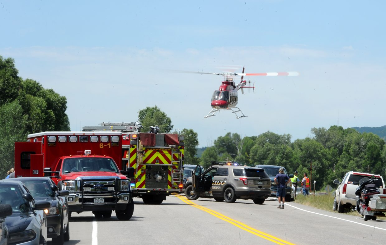 A Classic Air helicopter takes off from the scene of a motorcycle crash on U.S. Highway 40 on July 15. The man who was driving the motorcycle was airlifted to Yampa Valley Medical Center in critical condition, where he later died.
