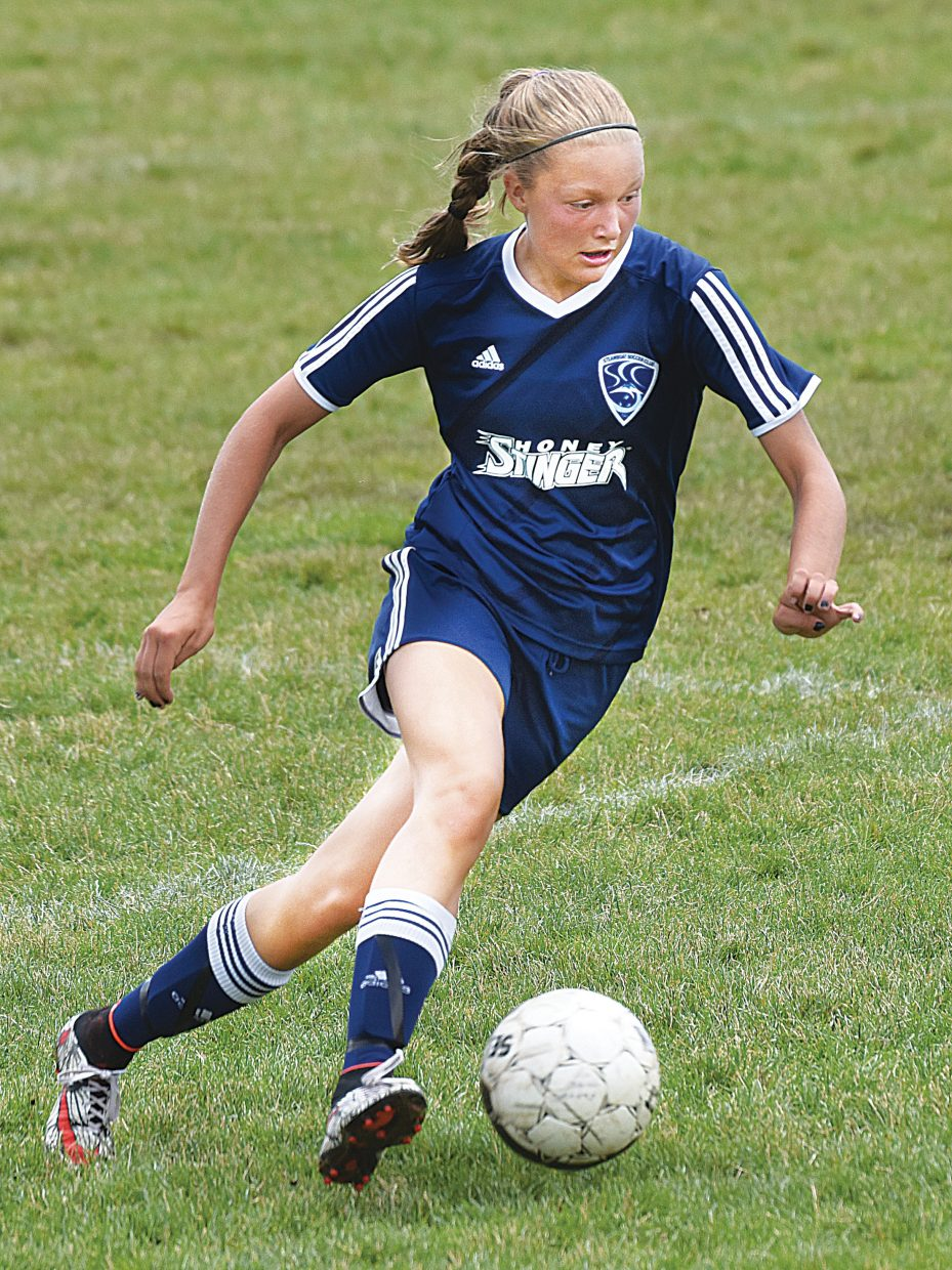 Steamboat Springs midfielder Sydney Graham moves the ball up the field during the Steamboat U14 Navy's Game against Rock Springs on Friday. Steamboat lost a heartbreaker falling to Rock Springs 1-0. The game was part of the Steamboat Mountain Soccer Tournament, which opened play Thursday and will continue through Sunday.