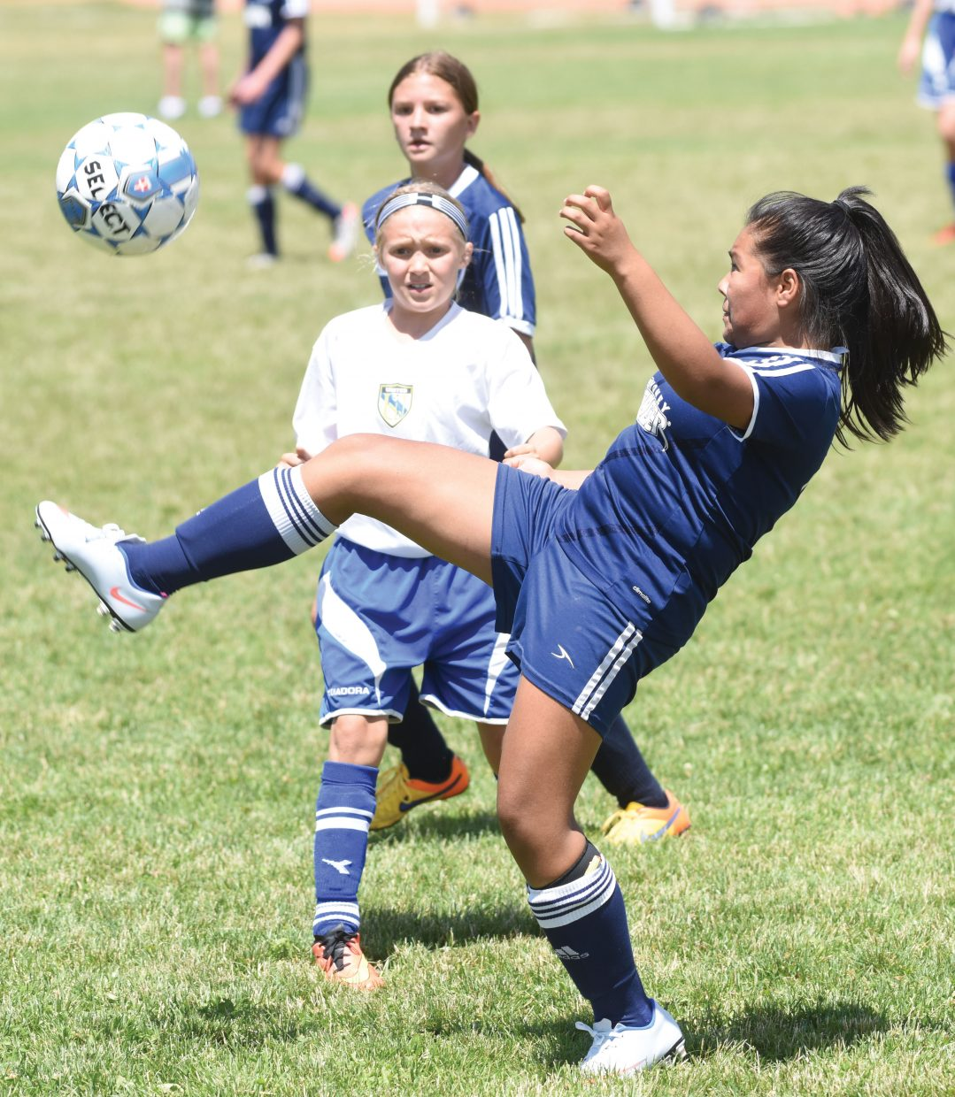Steamboat's Emili Campoverde attempts to clear a ball in a game against the North Platte United Hornets Friday at Ski Town Park on the second day of the Steamboat Mountain Soccer Tournament. The event brought 154 teams to town and included four days of soccer at fields around Steamboat Springs.