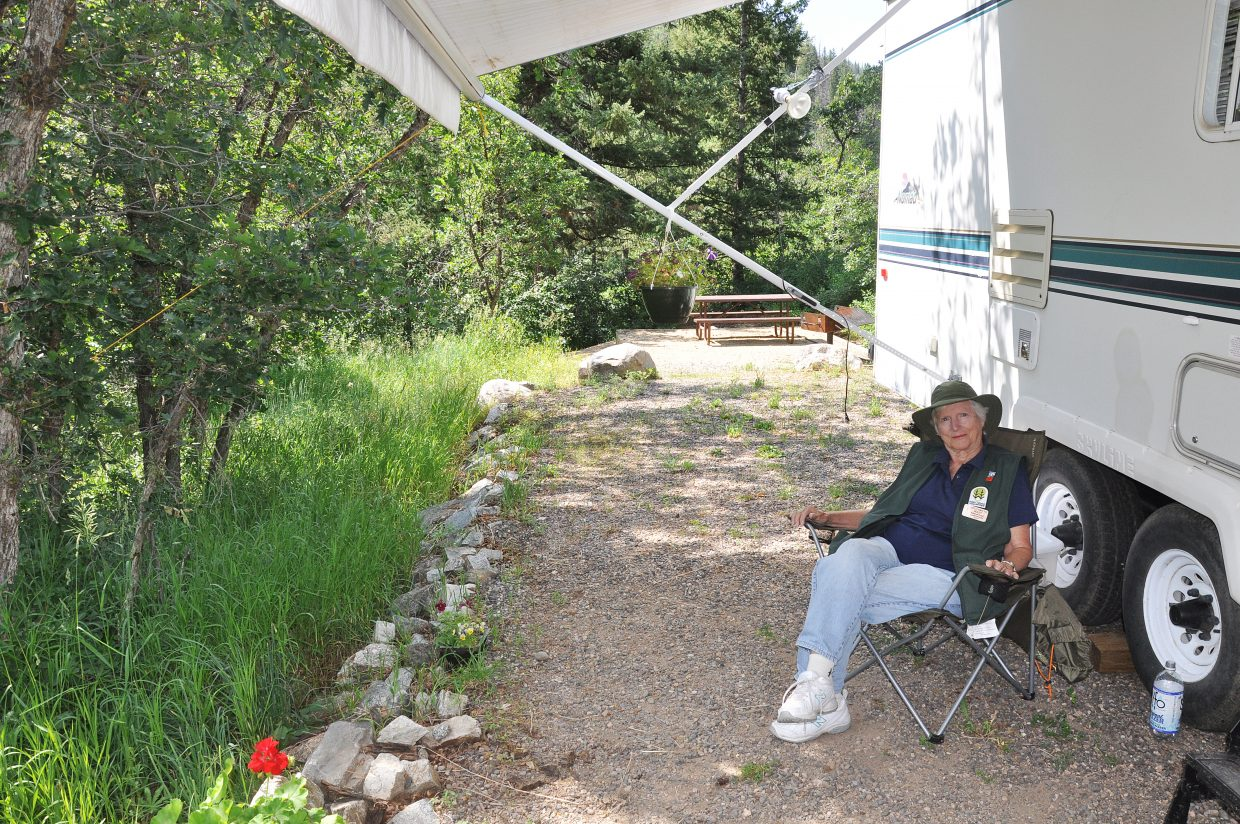 Nina Lowe spends her summer living in a camper at the start of the trail to Fish Creek Falls.