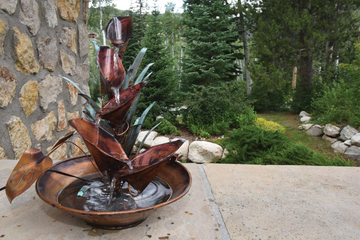 A fountain sits in the yard of Judith Harrington's home at 3053 Aspen Wood Drive in Steamboat Springs. Her garden and kitchen will be featured in this year's Strings Kitchen & Garden Tour this Saturday. The event , which features six homes will begin at 8:30 a.m. with a continental breakfast. The tours will begin at 9 a.m. and continue until 3 p.m. The last entry into homes is at 2:30 p.m.