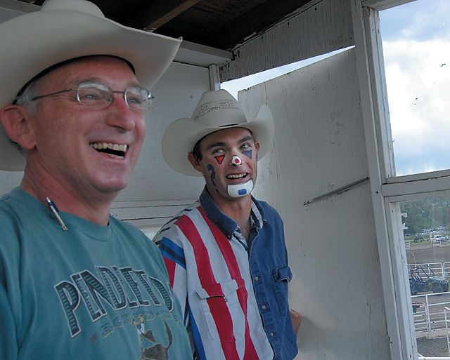 Rodeo announcer John Shipley and clown J.W. Winklepleck share a joke before a rodeo during a previous season. Shipley said getting a good repoire with a rodeo clown is key, and that he has a great one with this weekend's entertainer, Troy Lerwill.