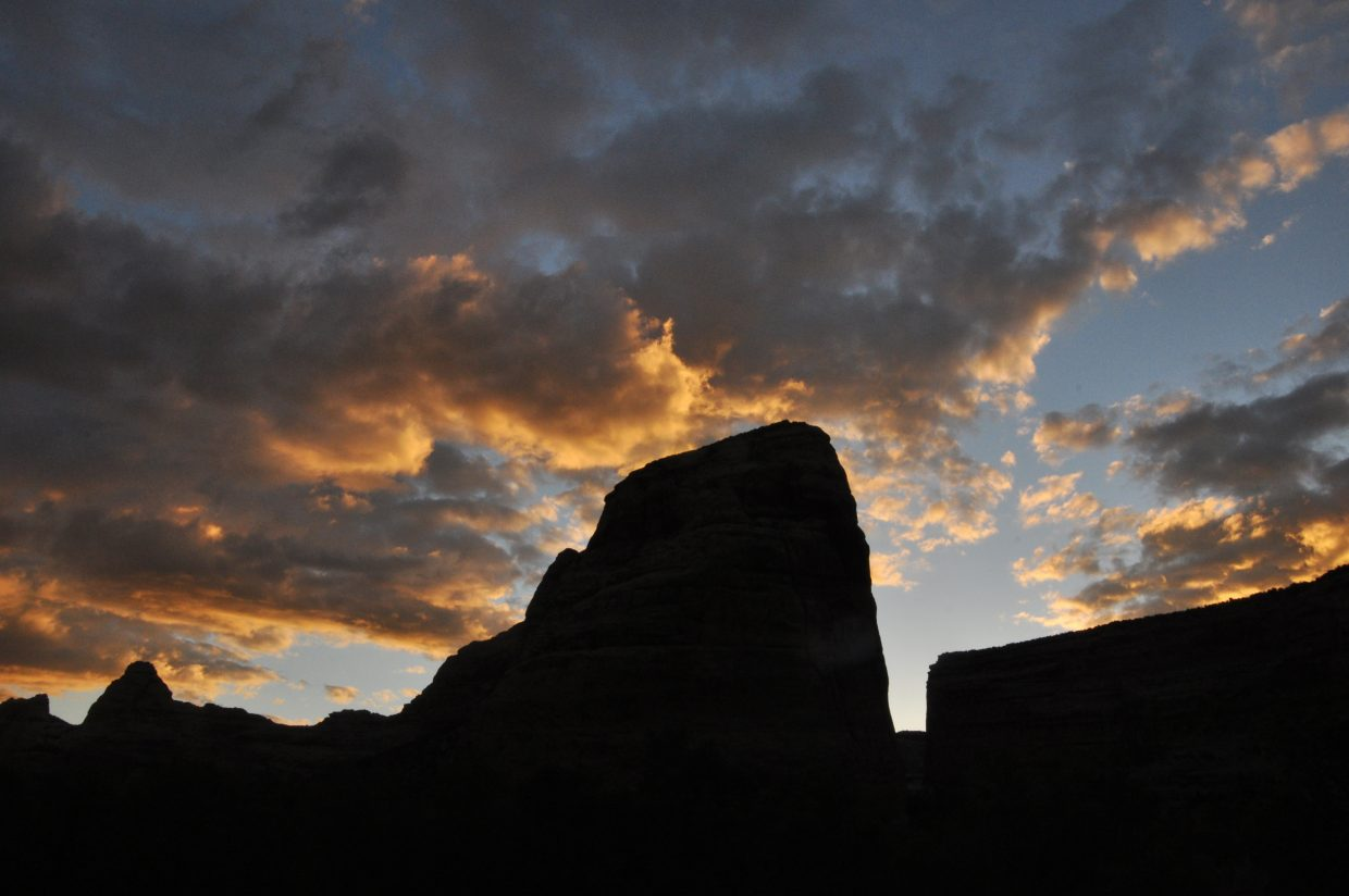 Clouds light up around Steamboat Rock at sunrise in Echo Park.
