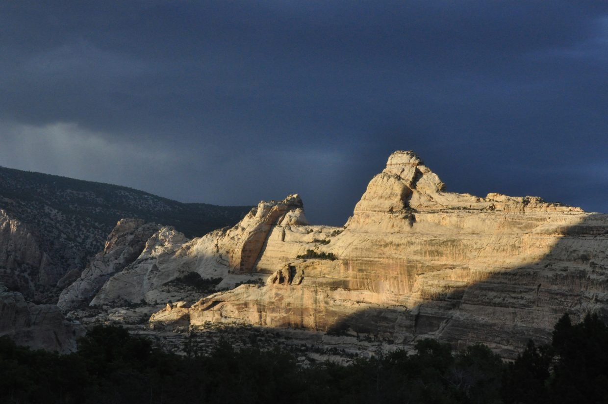 The last rays of light illuminate the canyons around Echo Park near the confluence of the Yampa and Green rivers. The primitive campground rarely fills up and is surrounded by beautiful landscapes.