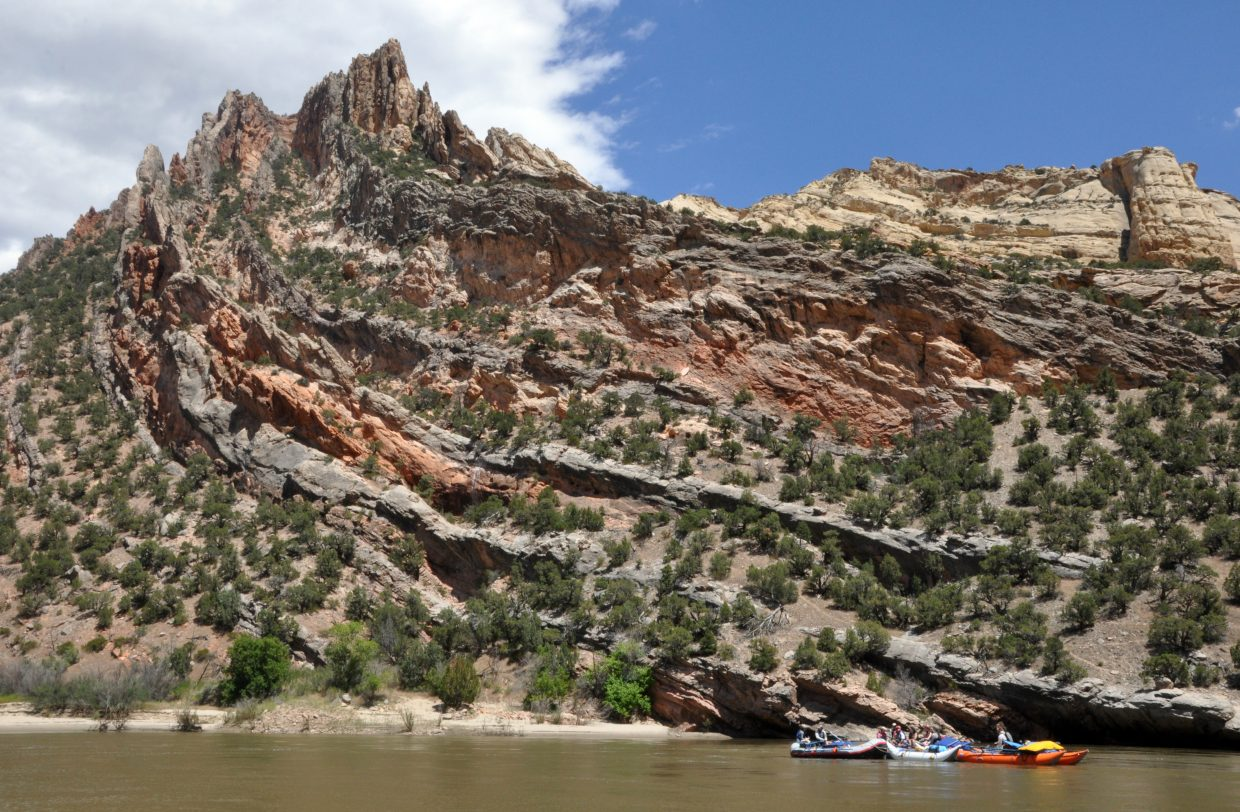 A group of rafters floats down the Green River deep in the heart of Dinosaur National Monument.