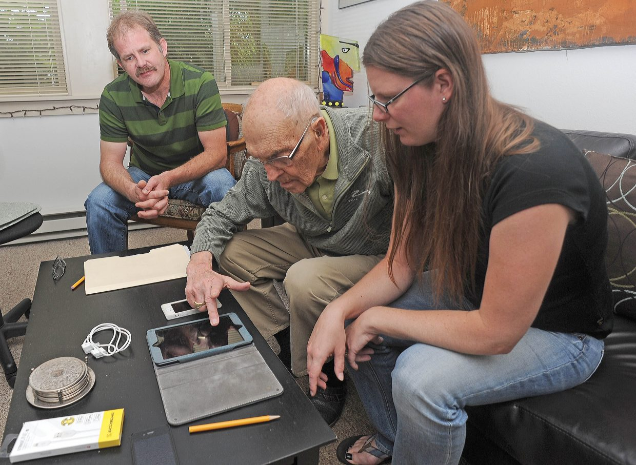Marcus Worthen, president and network engineer for Ski Town Computing, and co-worker with Amy Johnson help Jim Erickson sync his tablet and phone at the Mountain View Manor senior apartments in downtown Steamboat Springs on Friday. Ski Town Computing took the afternoon to work with residents at the apartments with any technical issues they might be having.