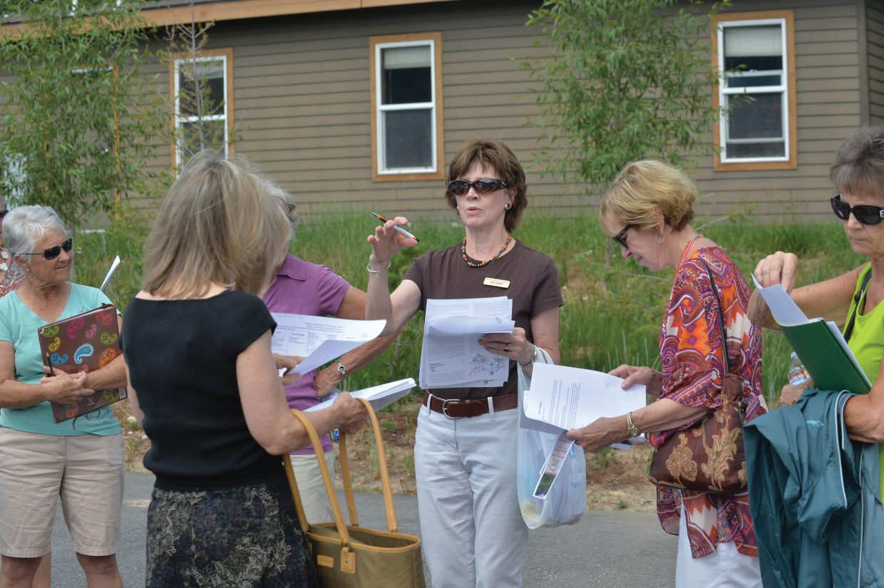 Lori Grant organizer volunteers for this year's Strings Music Festival Garden and Kitchen Tour earlier this week. The tour will take place Saturday and includes eight stops in the Steamboat Springs area.