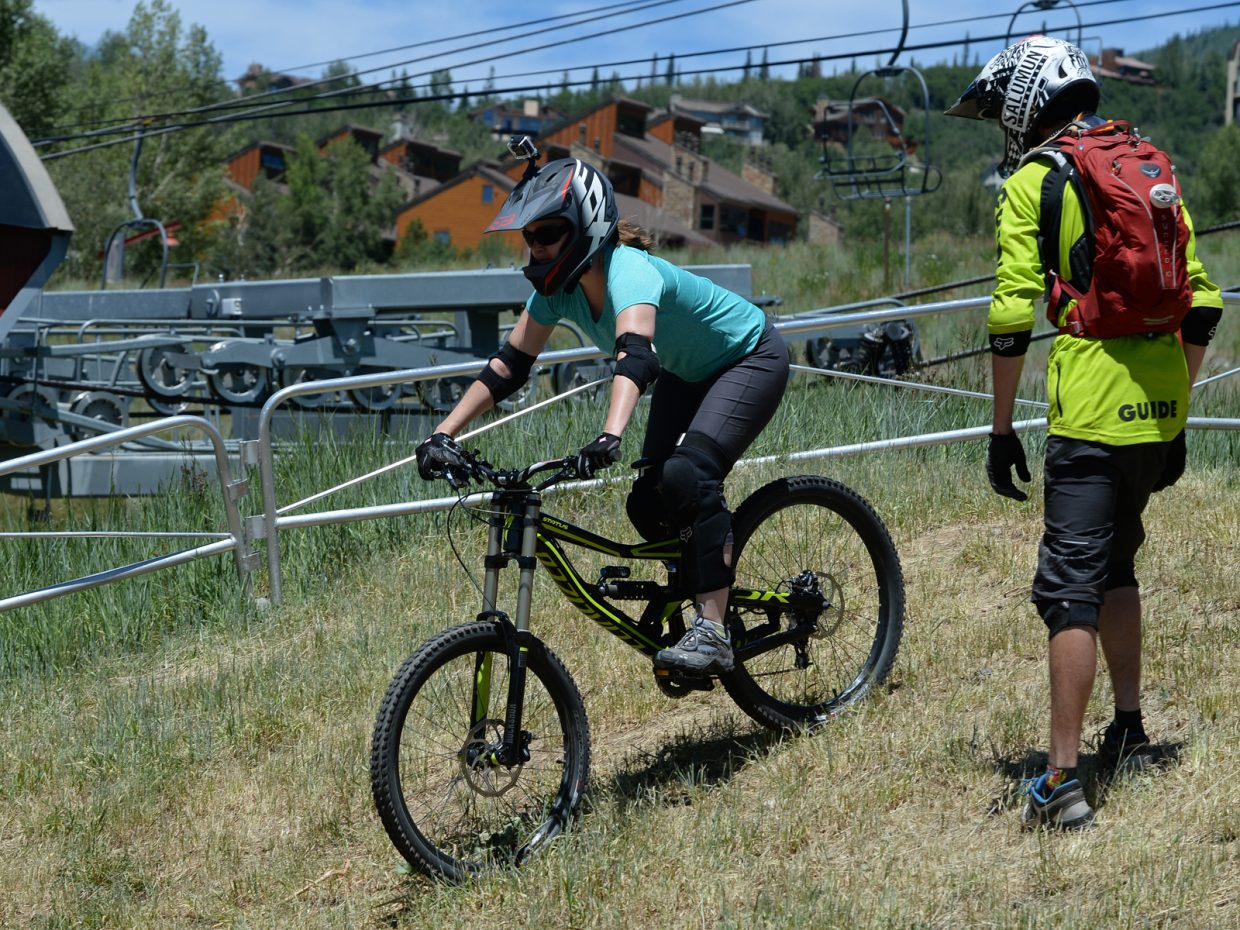 Nicole Miller learns the basics of downhill mountain biking during a 101 bike lesson at Steamboat Ski Area.