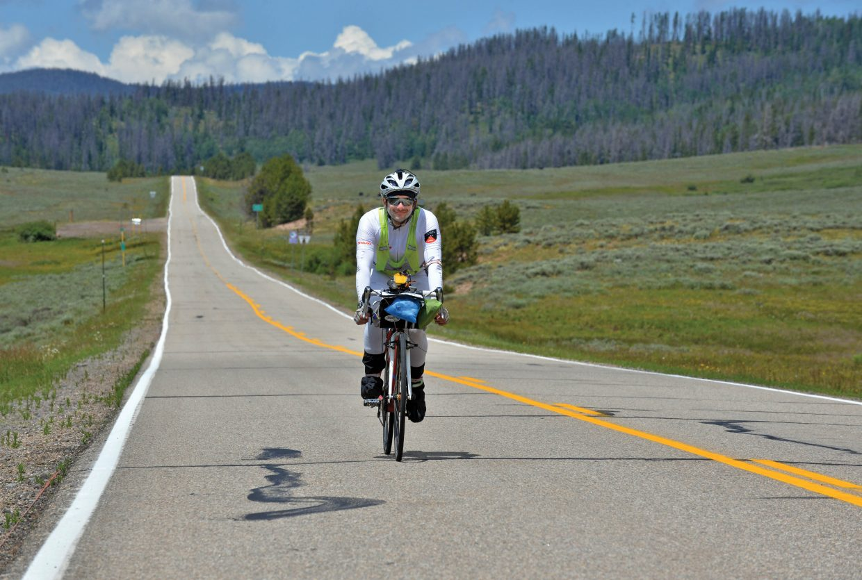 Cyclist Hector Maytorena completes a long stretch of road as he made his way over Gore Pass on Thursday afternoon.