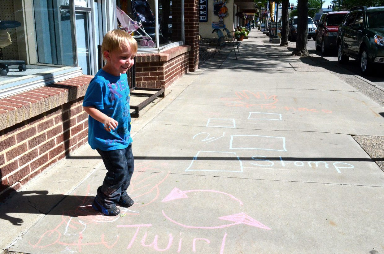 Quinn O'Brien, 4, jumps around at the Do it Downtown Thursdays kids' activities event sponsored by the Downtown Business Partnership.