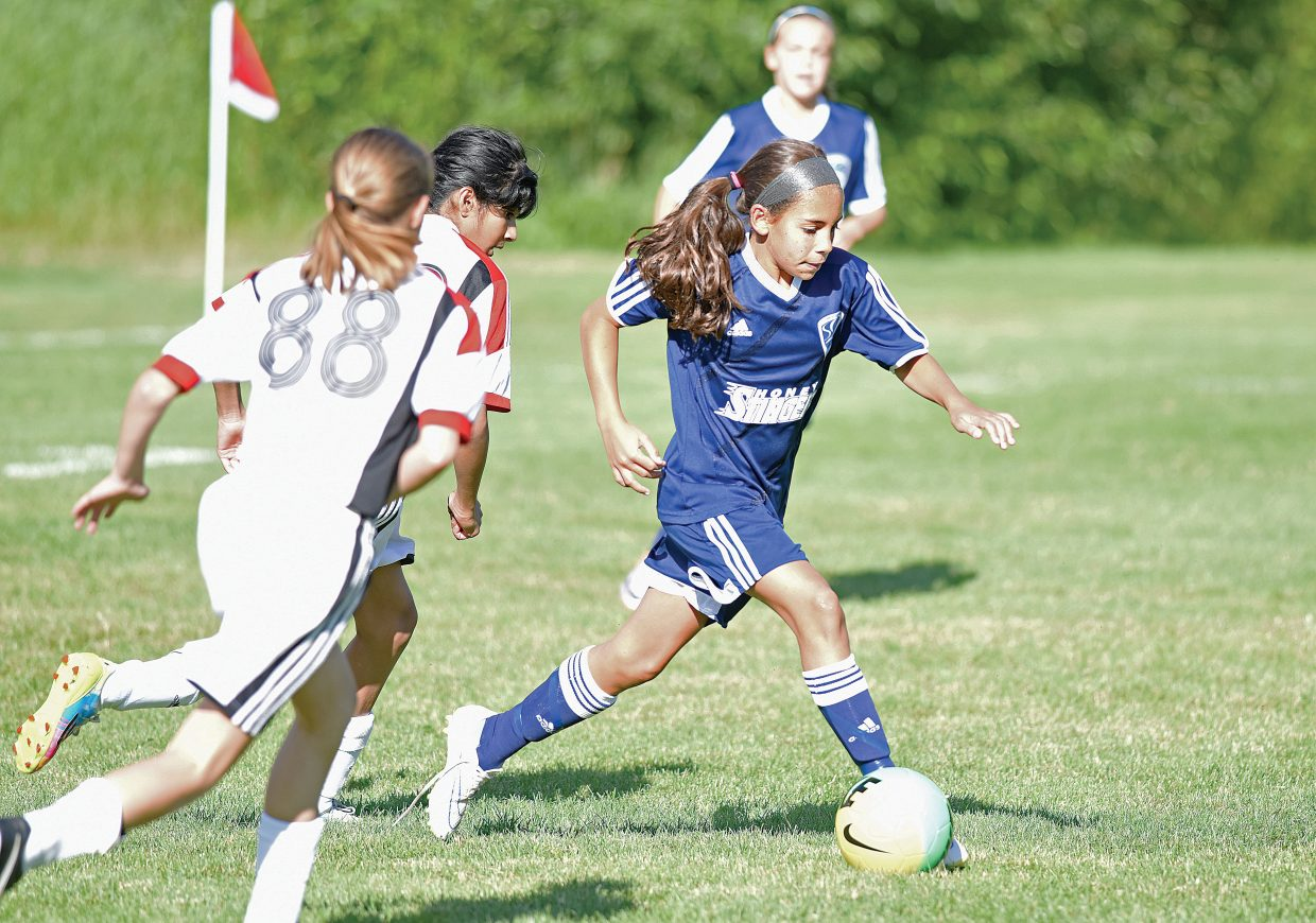 Marissa Drobek, of the Steamboat Springs U12 girls soccer team, moves the ball out of her end during the team's first game of the Steamboat Mountain Soccer Tournament Friday morning at Emerald Fields. The local team fell to the Pride White from Colorado Springs, 3-0.