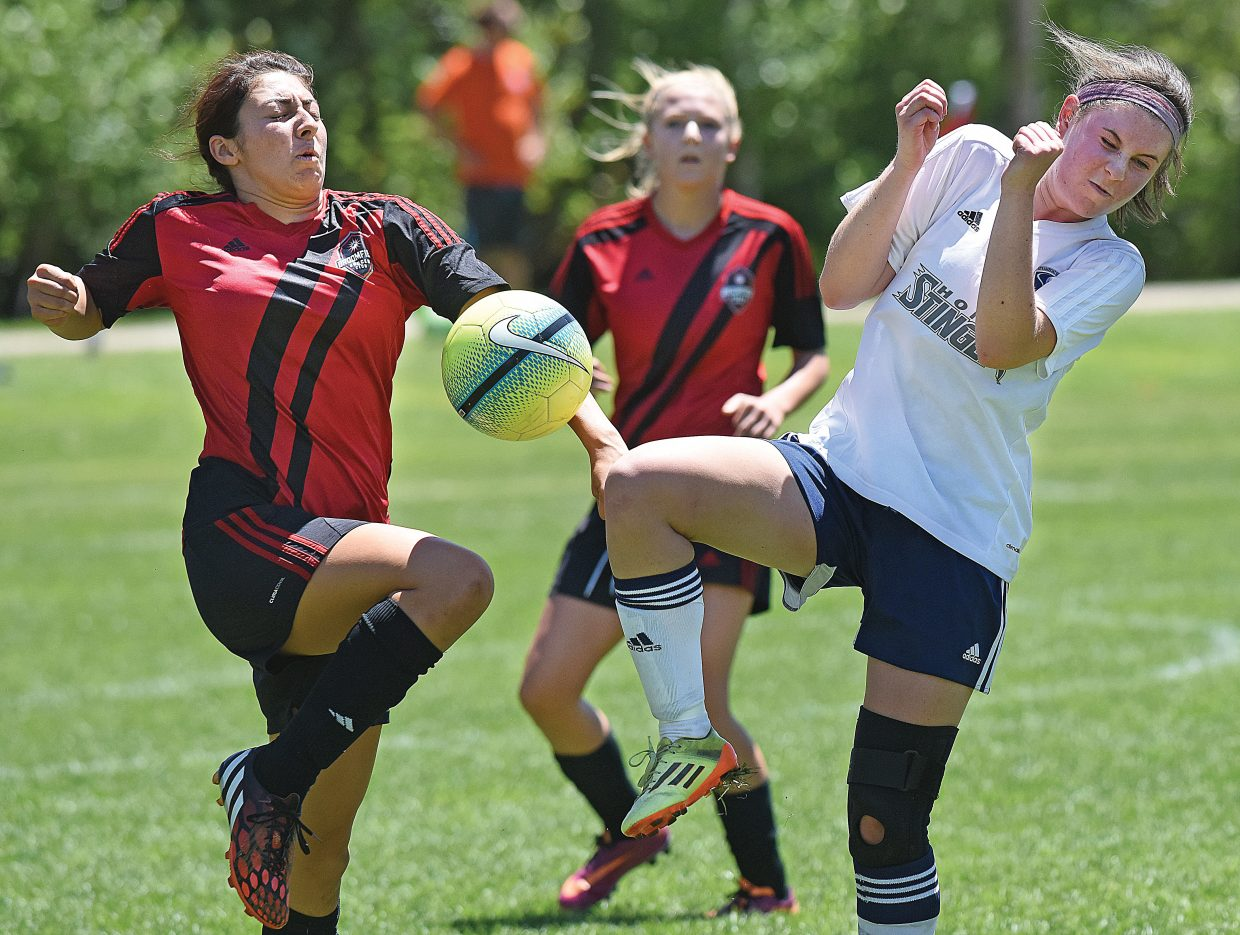 Jenny Adler battles a player from the Broomfield team during a 3-1 loss Friday afternoon during the second day of the Steamboat Mountain Soccer Tournament. One hundred sixty teams were in town battling for titles in the annual fundraiser for the Steamboat Springs Youth Soccer Association.