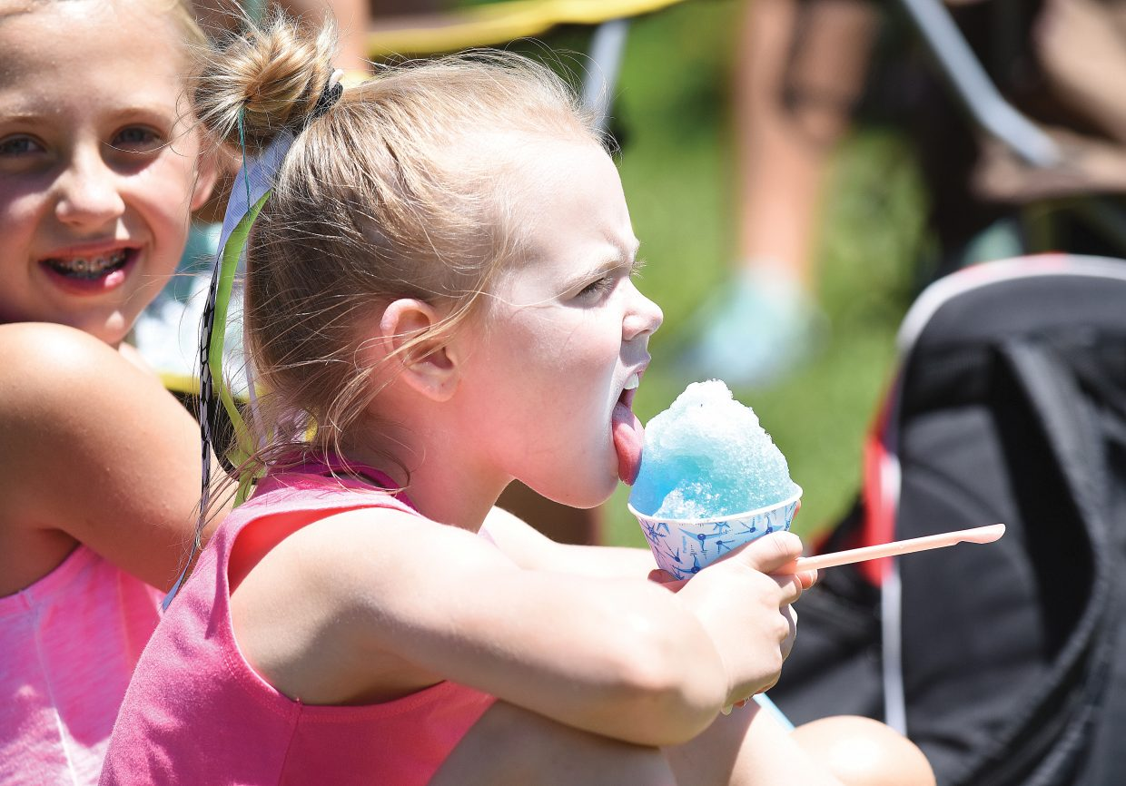 Kenidee Scott, of Rock Springs, Wyoming, eats a snowcone while watching a soccer game at the Steamboat Mountain Soccer Tournament Friday afternoon. One hundred sixty teams are in town for the four-day tournament, which began Thursday and will wrap up with the finals Sunday morning.
