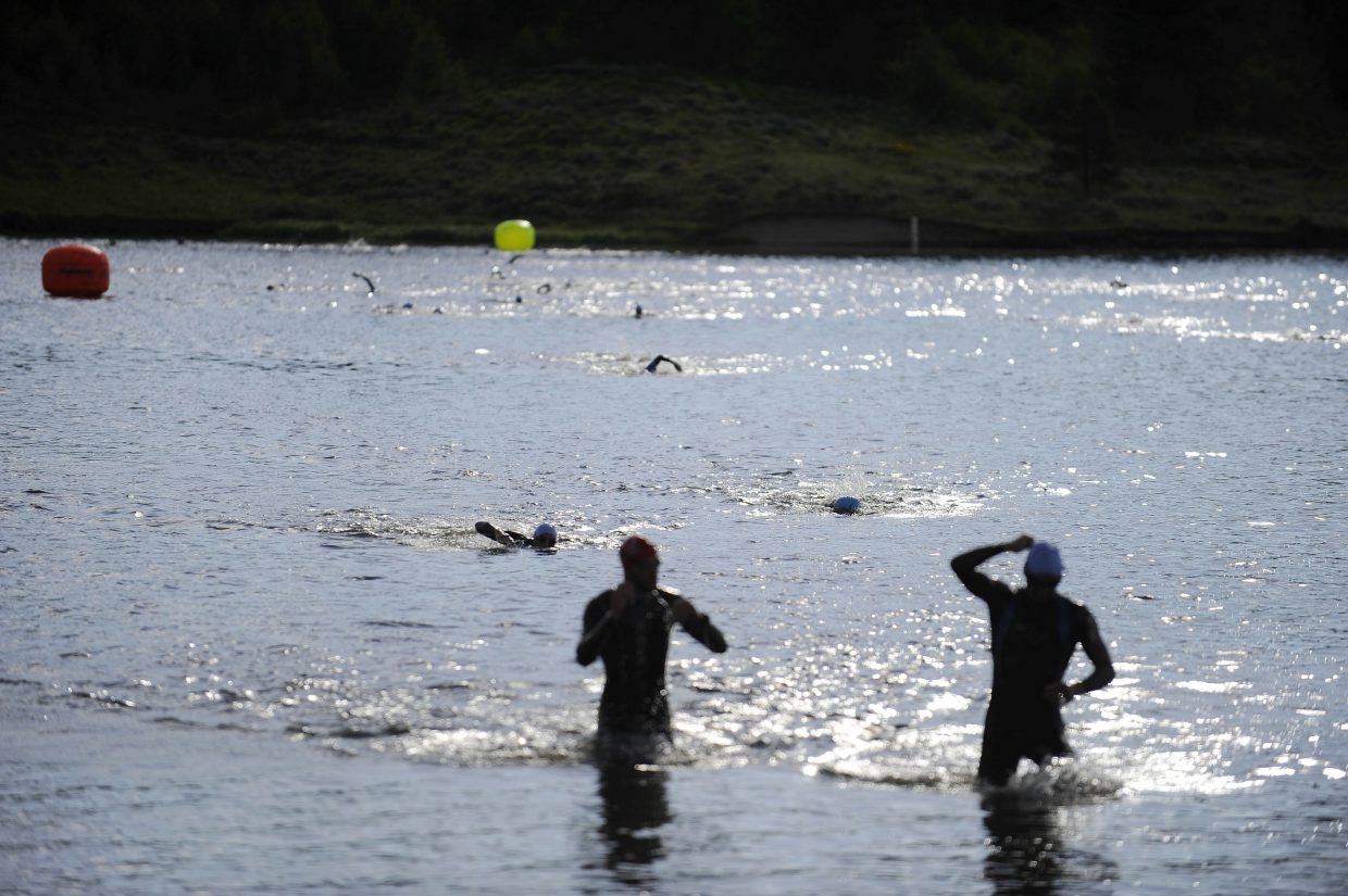 Triathletes compete in the swim portion of the Steamboat Lake Triathlon on Sunday.
